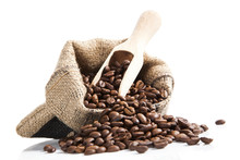 Coffee Beans In Bag With Wooden Spoon.