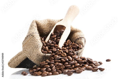 Papiers peints Salle de cafe coffee beans in bag with wooden spoon.