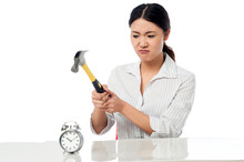 Frustrated Woman Smashing An Alarm Clock