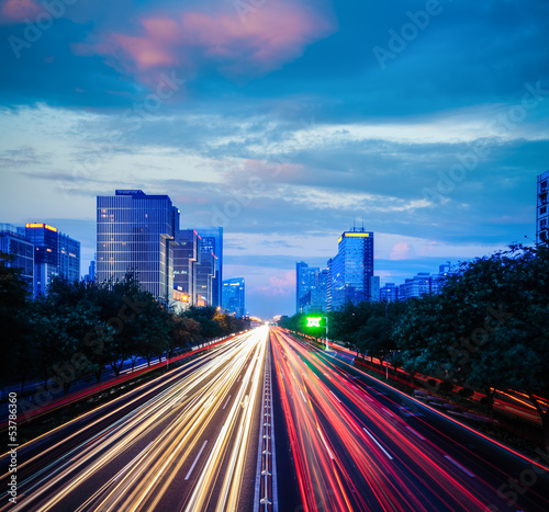 beijing cityscape at dusk with traffic