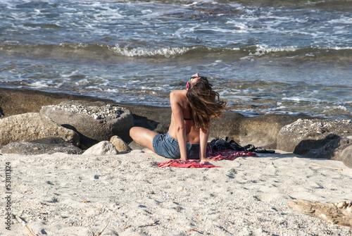 Fototapety, obrazy: Pretty girl on sea coast near water