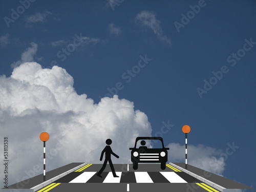Photo  Pedestrian walking across a zebra crossing