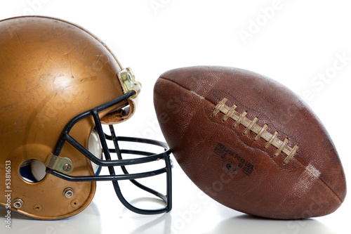 Deurstickers Retro A retro gold football helmet and football on a white background