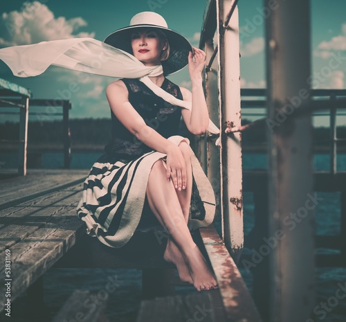 Stylish beautiful  woman on an old pier - 53831169