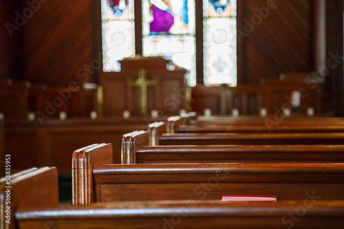 Fotografie, Obraz Church Pews with Stained Glass Beyond Pulpit