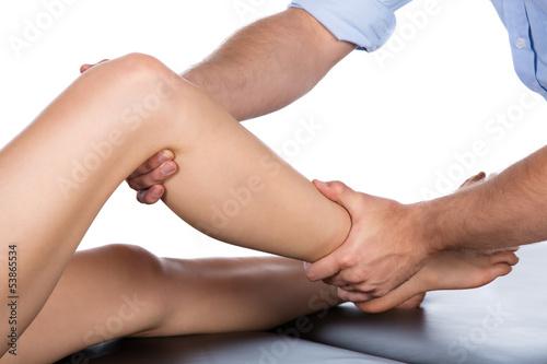 Fotografia  Physiotherapist massaging patient