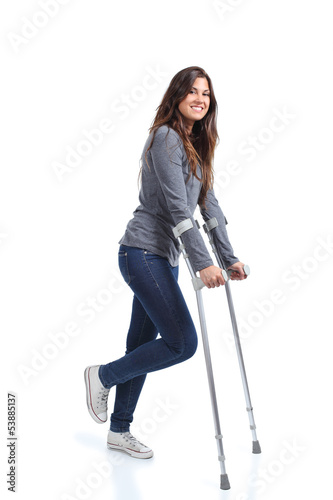 Fotomural Woman walking with crutches