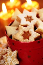 Christmas Cookies In Red Tin And Candles
