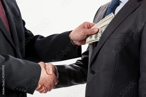 Fotografía  Giving a bribe into a pocket