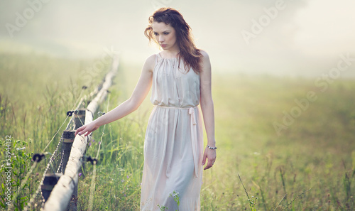 Serious look of young delicate woman