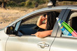 Woman driving car on vacation and looking ahead
