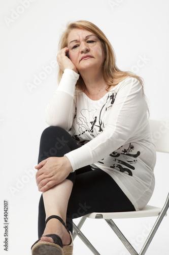 Fotografie, Obraz  senior woman portait sitting with serious expression