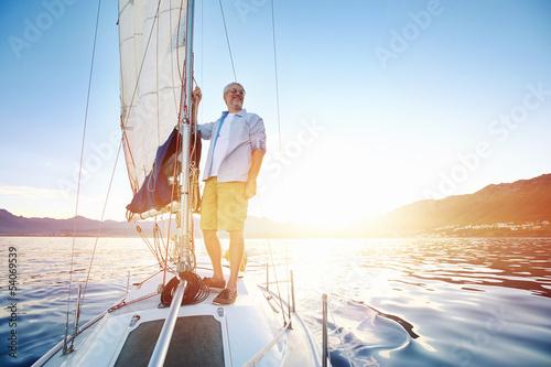 Vászonkép  sunrise sailing boat