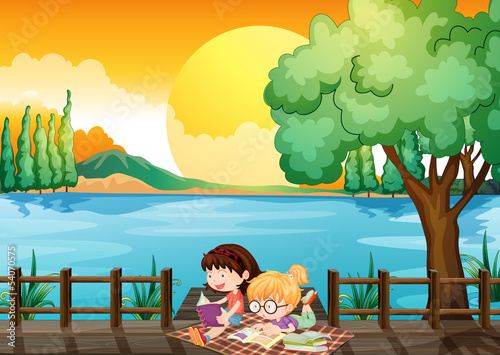 Aluminium Prints River, lake Two girls studying at the wooden bridge