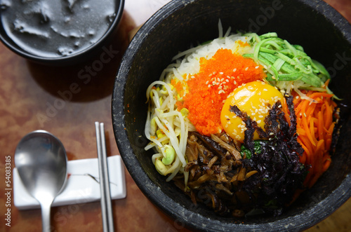 Korean cuisine : bibimbap in a heated stone bowl Lerretsbilde