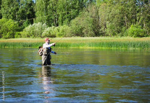 Deurstickers Vissen Fisherman catches of chub fly fishing in the Chusovaya river