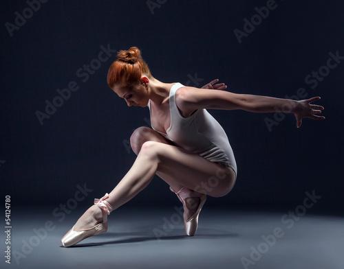 Graceful slender ballerina dancing in studio плакат