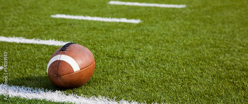 An American football on field Wallpaper Mural