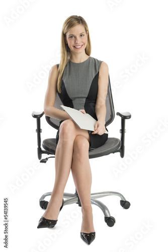 Fotografie, Obraz  Businesswoman With File Sitting On Office Chair