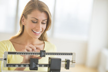 Woman Weighing Herself On Balance Scale