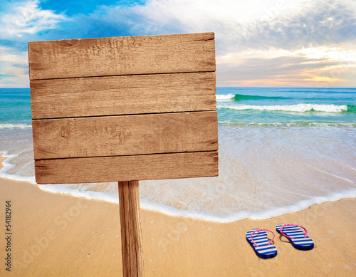 Staande foto Strand wood sign on beach