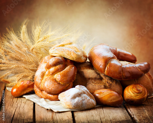 Bakery Bread on a Wooden Table. Various Bread and Sheaf - 54212530