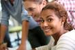 Cheerful student girl looking at camera