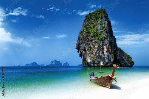 Poster Beach Thailand beach in tropical island. Travel boats at summer in sea