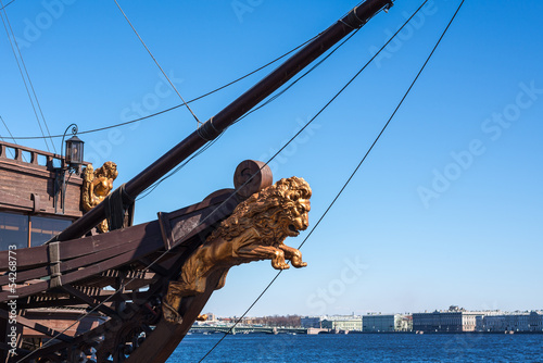 Bow of the sail boat with figurehead of the lion Fotobehang