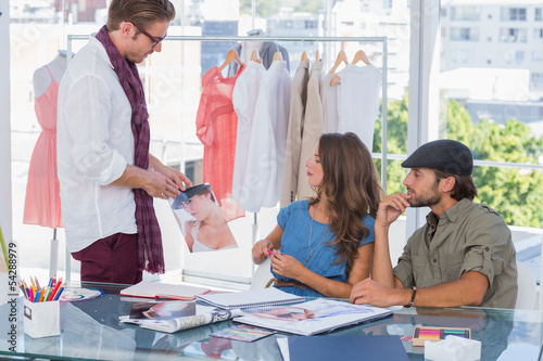 Fototapety, obrazy: Attractive designer showing a picture
