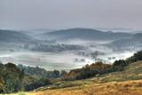 Rural mountain village in fog aerial view - 54308753