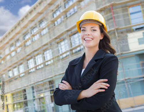 Fotografie, Obraz  Portrait of Female Contractor Wearing Hard Hat at Construction S