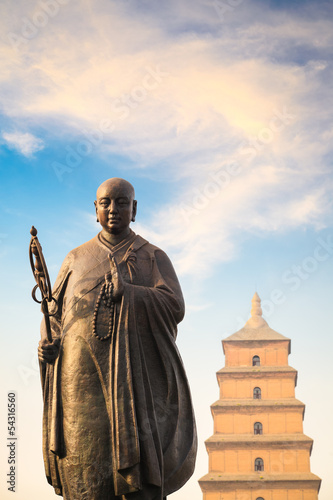 monk xuanzang statue with big wild goose pagoda