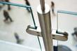 Leinwanddruck Bild - Fittings of glass fence