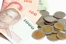 Thai Banknotes And Coins On Wh...