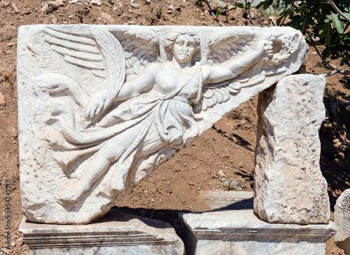 Fotografija  Stone carving of the goddess Nike at ancient Ephesus, Turkey
