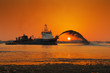 canvas print picture - A dredging ship in action at Palm Jumeirah, Dubai, UAE