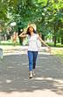 Beautiful young woman walking in park, Serbia.