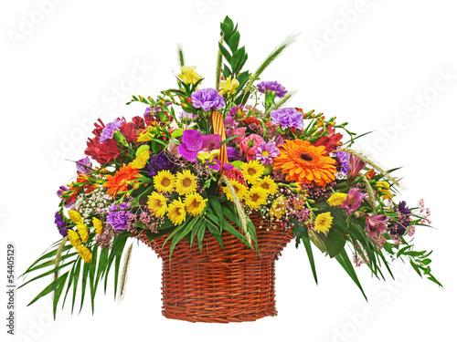 Foto op Canvas Madeliefjes Colorful flower bouquet arrangement centerpiece in wicker basket