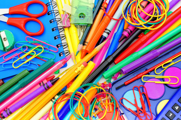 Fototapeta samoprzylepna Full background of a colorful assortment of school supplies