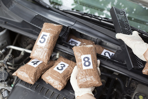 Photo  hidden drugs in a vehicle compartment