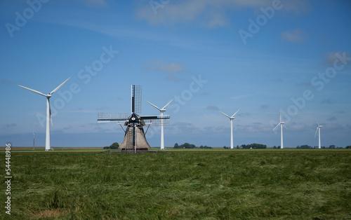 Dutch windmill and wind turbines