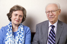 Elderly Couple Looking At Camera