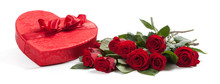Valentine's Gifts Including A Bouquet Of Roses And Candy Heart