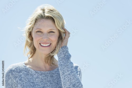 Photographie  Woman With Hand In Hair Against Clear Sky