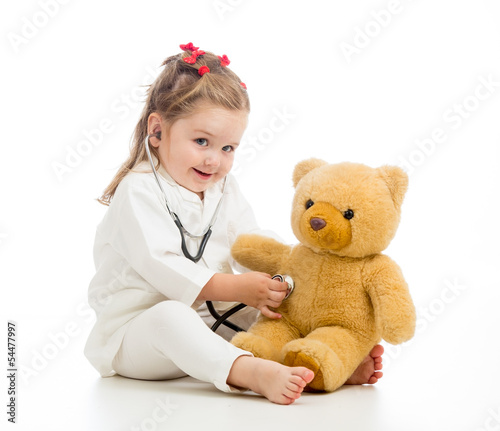 kid girl with clothes of doctor playing with toy #54477997
