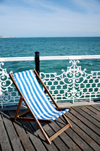 Deckchair On Brighton Pier, UK