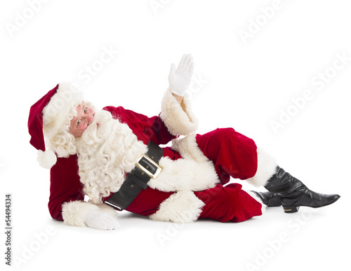 Fotografie, Obraz  Portrait Of Santa Claus Gesturing While Lying On Floor