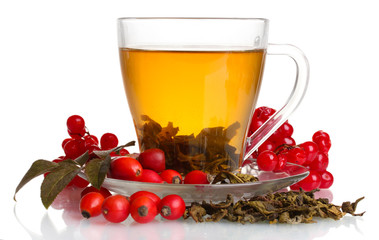 Panel Szklany Do herbaciarni Green tea with red viburnum and hips in glass cup isolated