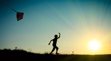 Child Running With A Kite